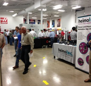 Oktoberfest Tool Show attendees browsing machine tool booths