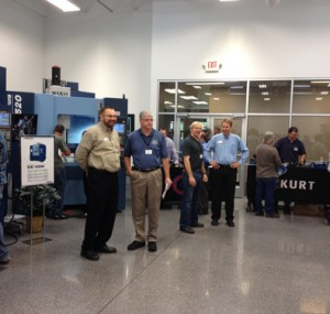 Men ready to teach attendees about tooling machines
