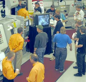 Attendees inspecting machine tools at the Oktoberfest Tool Show