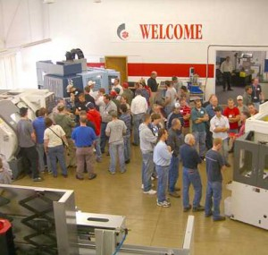 Oktoberfest Tool Show Attendees examining machines