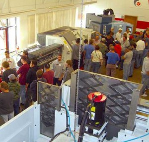 Attendees looking at machine demonstrations at Oktoberfest Tool Show