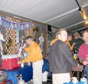 Attendees getting beverages at the Oktoberfest Tool Show