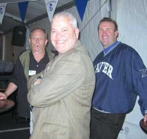 Three men smiling at the Oktoberfest Tool Show