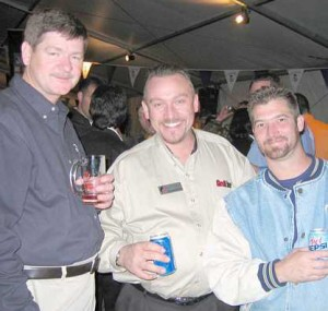 Attendees of Oktoberfest Tool Show drinking beer