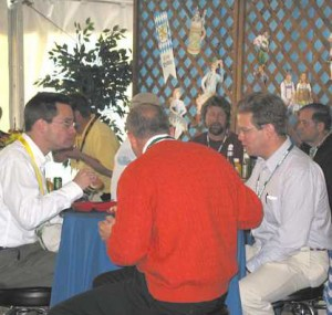 Men talking about tooling around a small table
