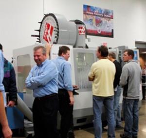 Men gathering around an automated machine