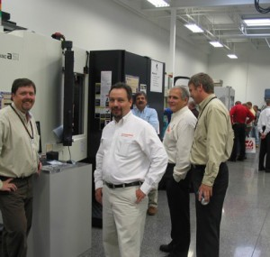 Men smiling in front of an automated machine