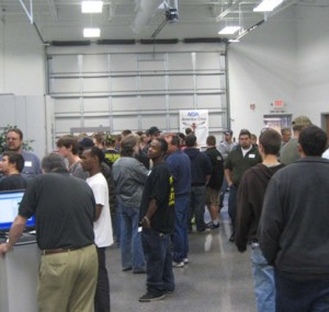 People congregating around booths at the Oktoberfest Tool Show