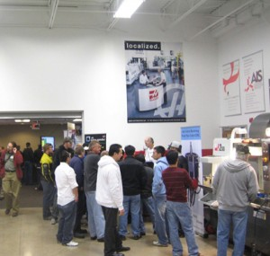 Attendees looking at different machine tools