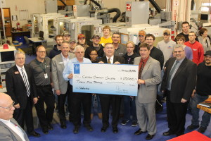 Productivity Inc Presents Gene Haas Foundation check