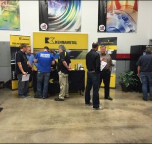 Attendees networking in front of the Kennametal booth