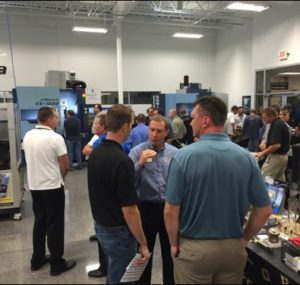 Attendees browse machine tool booths at Oktoberfest Tool Show