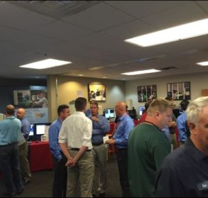 Attendees networking at the Oktoberfest Tool Show booths