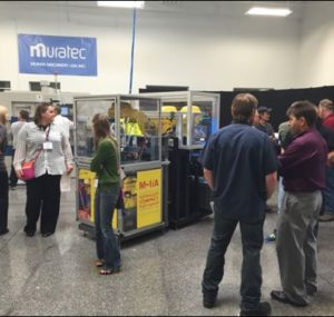 Oktoberfest Tool Show attendees looking at machine tool demonstrations