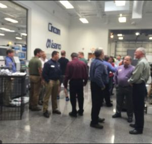 Group of men discussing machine tools at Oktoberfest Tool Show