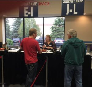 Oktoberfest Tool Show attendees checking in
