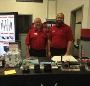 RedLine Tools team in front of Oktoberfest Tool Show booth