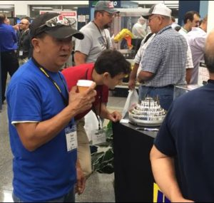 Man drinking coffee at the Oktoberfest Tool Show