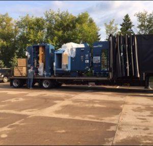 Man loading truck of machine tools
