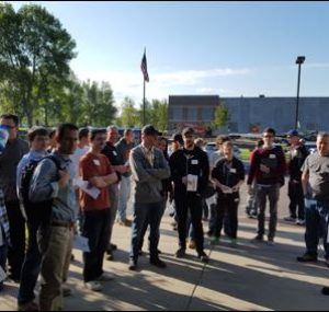 Group of students stand outside of the Oktoberfest Tool Show
