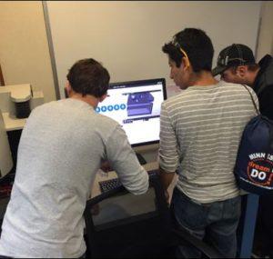 Oktoberfest Tool Show attendees looking at an online presentation